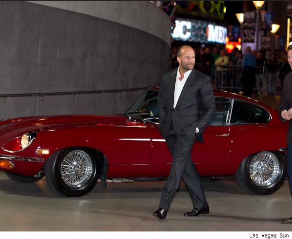 Jason Statham in a Jaguar E-Type